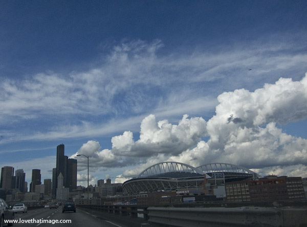 scenic clouds above qwest field, puffy white clouds, deep blue sky
