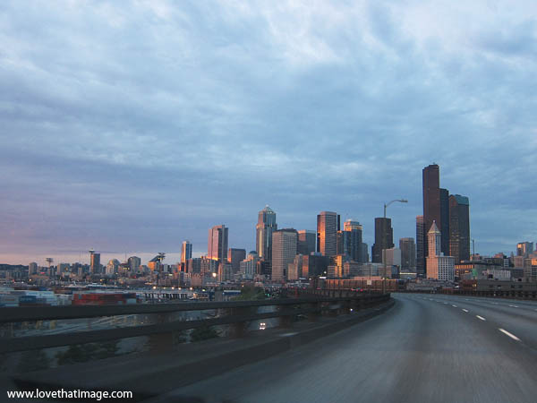seattle skyline, curved empty road, dusk, sunset, city, cityscape
