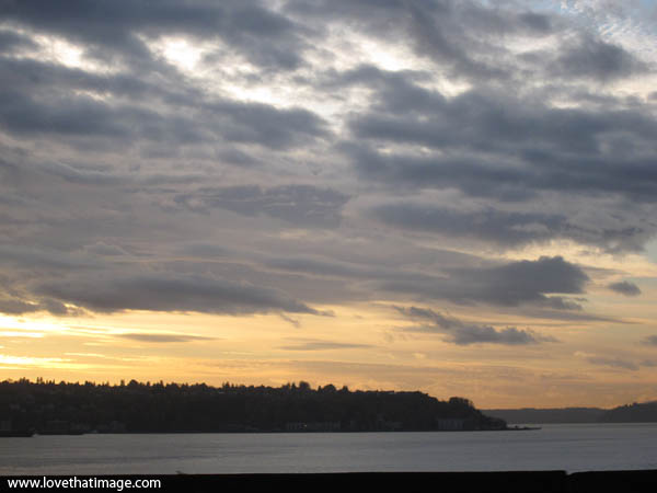 sunset with gray clouds, scenic seattle puget sound