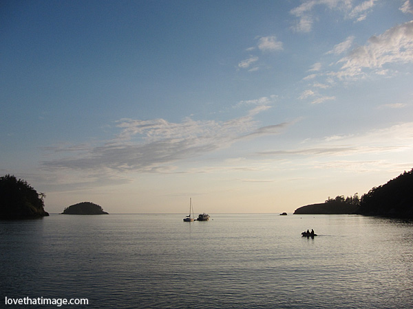 deception pass, deception pass state park, dusk at water's edge, sailboat at dusk, islands in silhouette