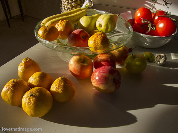 fruit bowl, still life, shadows, apples, oranges, pears, tomatoes, pineapple, round