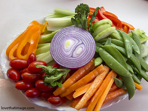 carrots, carrot sticks, celery sticks, sugar peas, grape tomatoes, orange peppers, red onion, broccoli florets, plate, kitchen, fresh, vegetables, cut up
