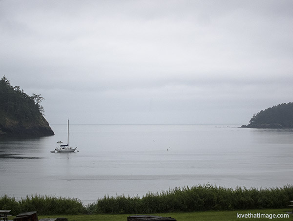 A sailboat at rest in Bowman Bay at Deception Pass State Park in Washington