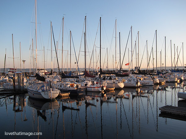 Sailboats at rest in the Des Moines, WA marina