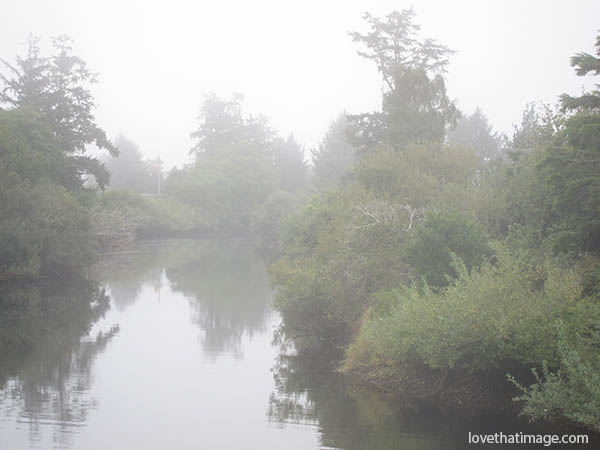 Foggy weather and the creek at high tide in Seaside, Oregon