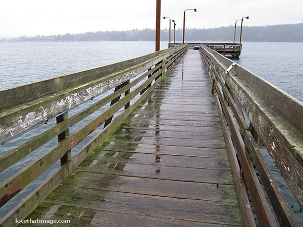 Reflections on a wet pier in Port Orchard, WA