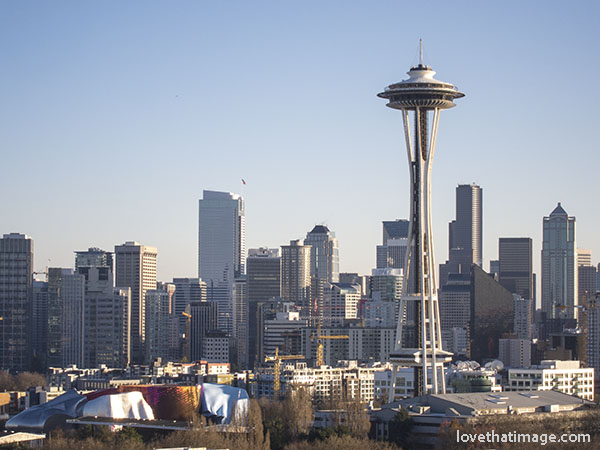 Seattle's iconic Space Needle against the skyline on a cold, sunny day