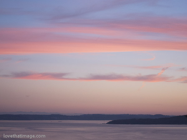 Bands of pink clouds over Puget Sound in Washington, at sunset