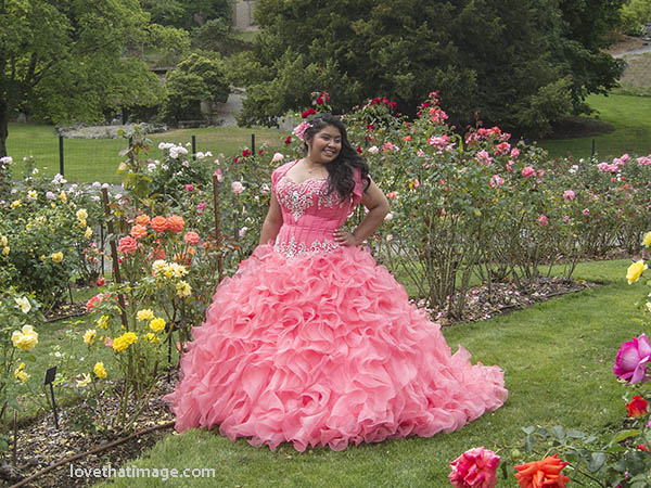 A 15-year-old girl poses for pictures in the park for her upcoming Quinceañera
