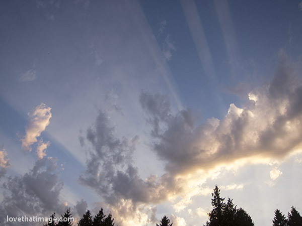"""Hand of God"" rays in the warm evening sky at dusk"
