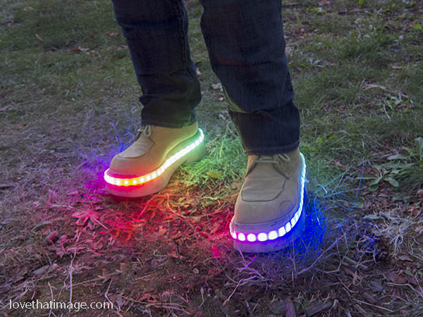 Rainbow LED lights decorate a pair of shoes