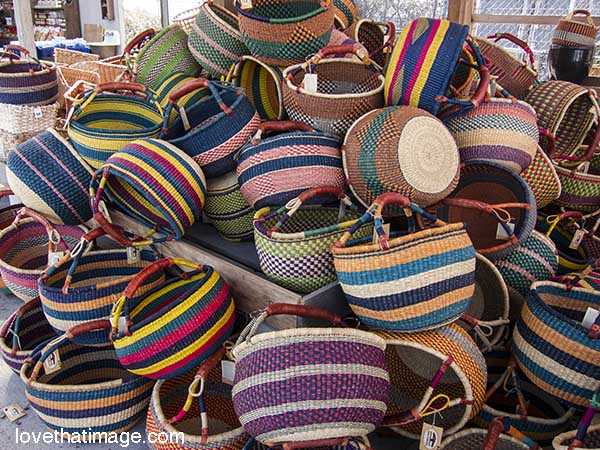 Colorful striped baskets handmade in Africa for sale in far-away Washington State.