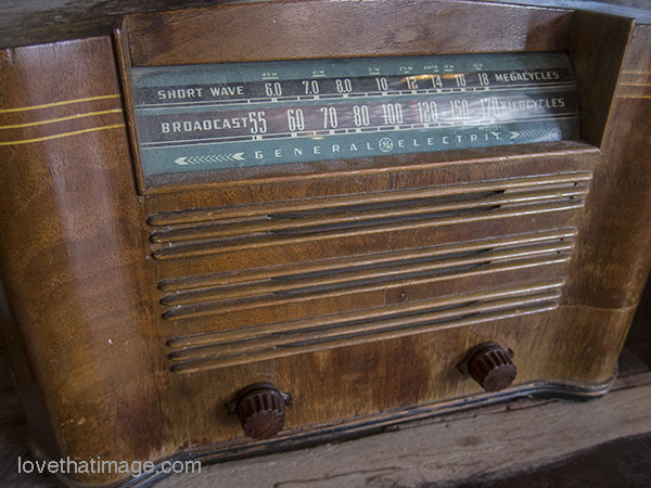 Old General Electric radio with wood case and two knobs