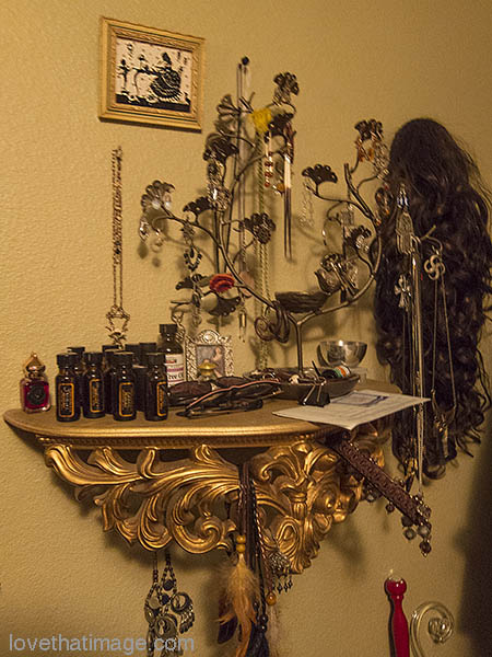 Gold sconce table holds jewelry and accessories for a lady