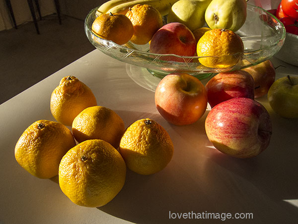 Apples and oranges and a green depression glass fruit bowl in my kitchen