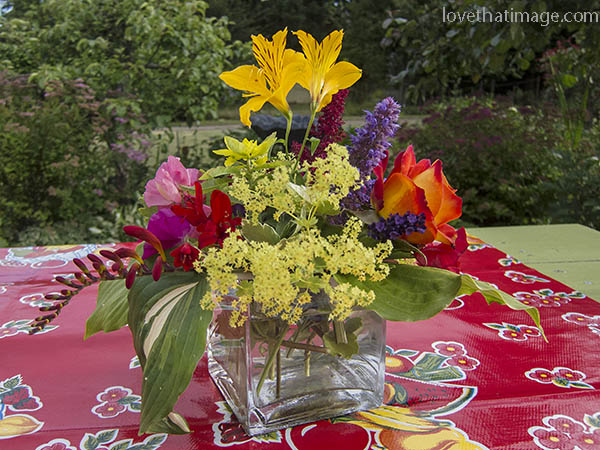 Colorful flowers on a picnic table