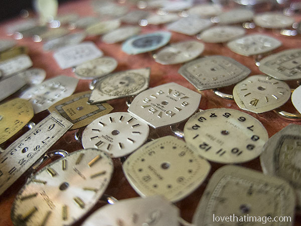 Macro of antique watch faces made into jewelry