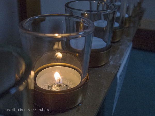 Votive candle lit in a Burien, WA Catholic Church