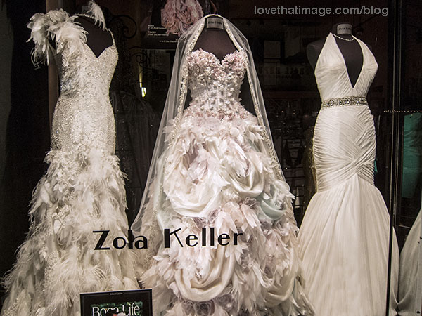 Flounced, feathered, jeweled and gathered white dresses by Zola Keller in a Las Olas shop window