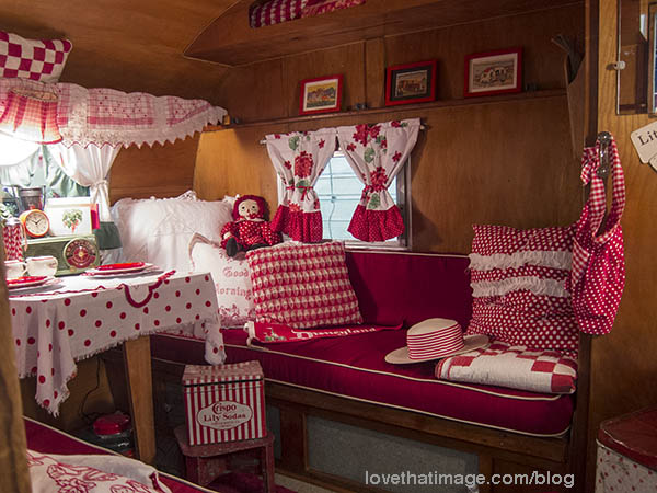 Darling interior of small trailer, in vintage red and white