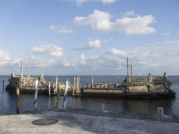 Statues and coral rock adorn the breakwater at Vizcaya