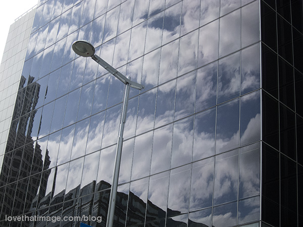 Sky and clouds reflected in glass-walled building in Miami, Florida