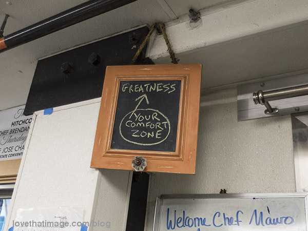 Your Comfort Zone -> Greatness sign in the Farestart kitchen