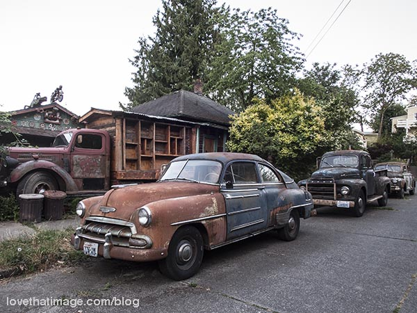 The group of antique rusted cars, and a truck, on Capitol Hill in Seattle