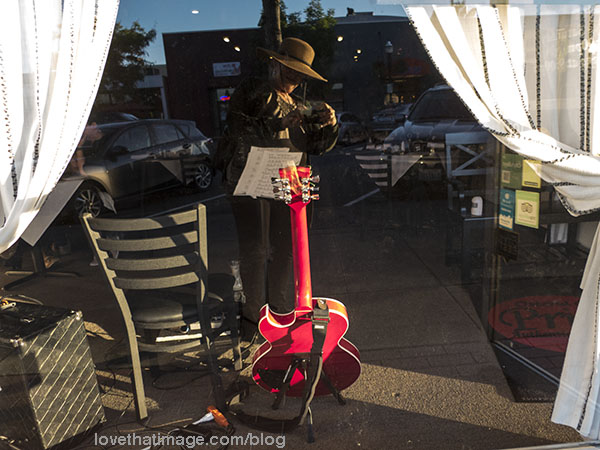 Bright red guitar, seen from the back, on break.