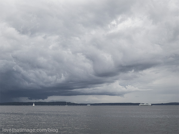 Rain threatens two sailboats and two ferries on Puget Sound