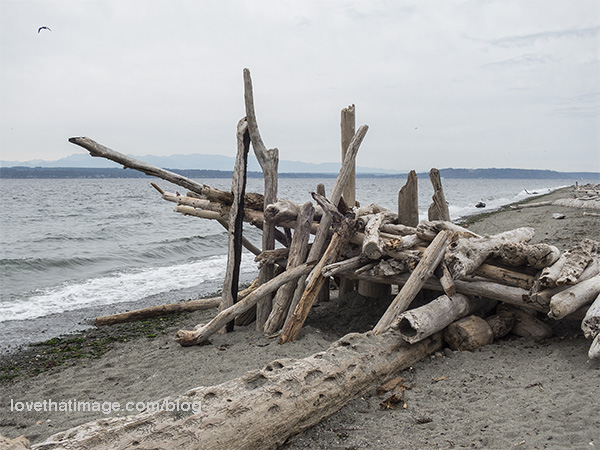 Perhaps a fort, made of driftwood on the beach