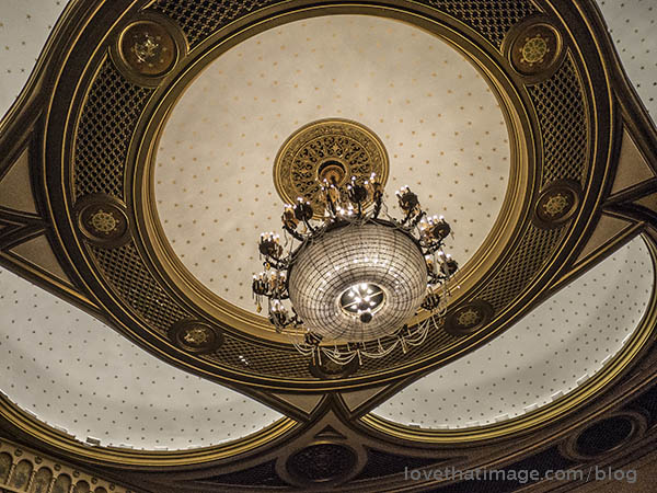 Magnificent old ceiling with gold, crystal and softly lit arches in the Palace Theater in Stamford, CT