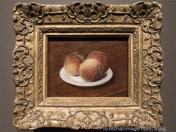 Inpressionist Fantin-Latour's small painting of peaches on a plate, in a fancy gold frame