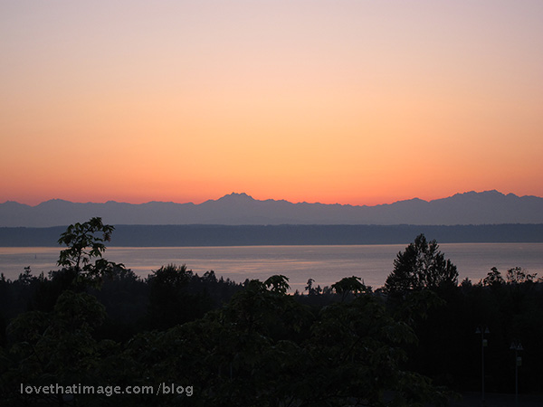 Sunset over Puget Sound, with Vashon Island and the Olympic Mountains behind it.