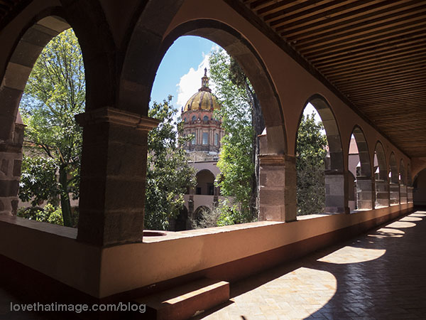 Spanish influence shows in the arches of this courtyard walkway at Bellas Artes in San Miguel