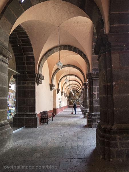 Groined vaulted ceilings around courtyard walkway in the Bellas Artes school in San Miguel