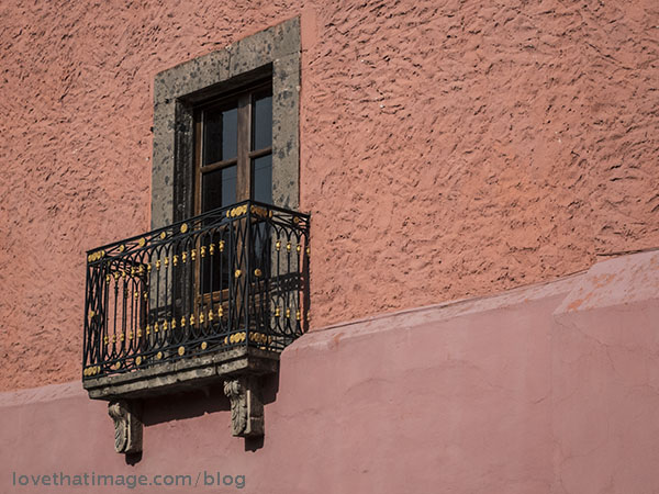 Rose and earth tones, and wrought iron railings in San Miguel