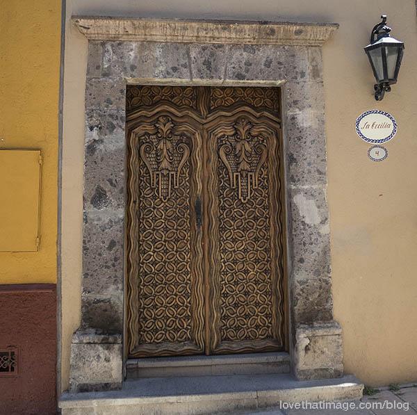 Carved wooden door in San Miguel de Allende, Mexico
