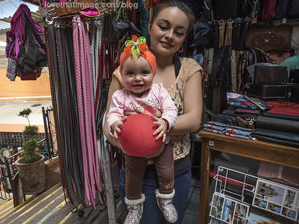 Adorable baby with red hat and ball in San Miguel de Allende