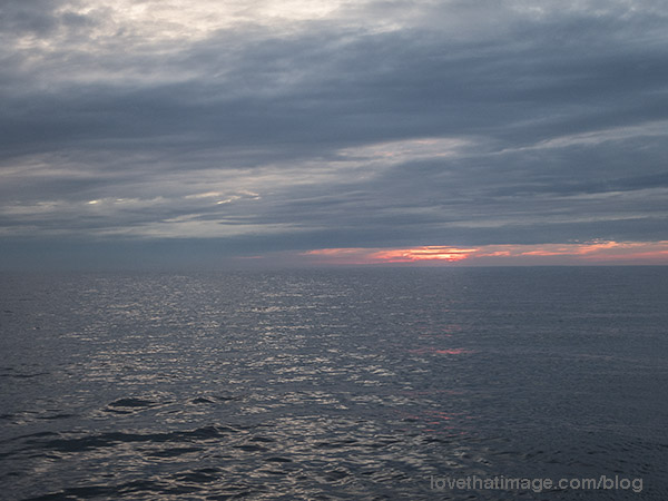 Sunset at sea, rain approaching