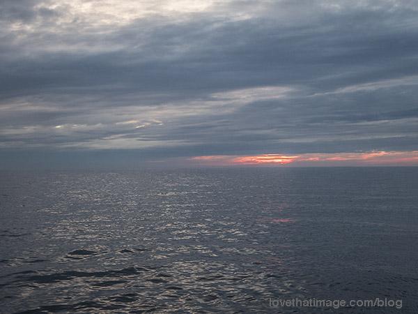 Sunset at sea, rain approaching
