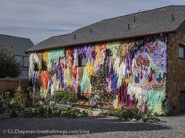 Entire outer wall of home in Edmonds, WA is covered in multi-colored fabric art.